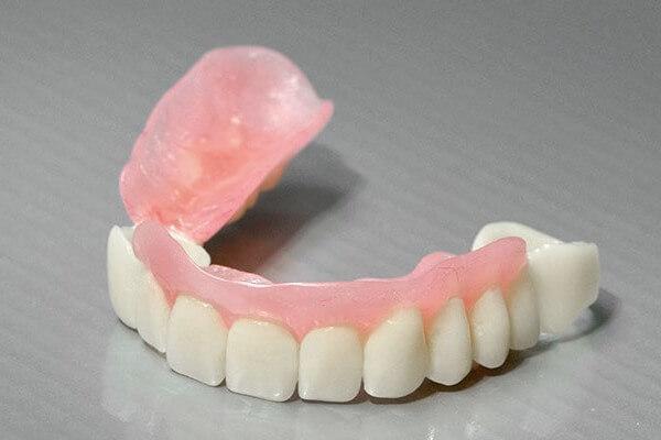 стоимость протезы на зубы Сэндвич