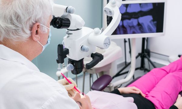 Лечение каналов зуба под микроскопом цена