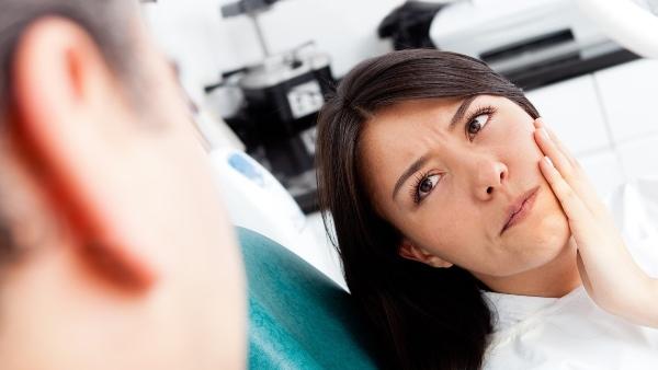 Болят ли зубы после имплантации