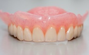 Силиконовые зубные протезы цена